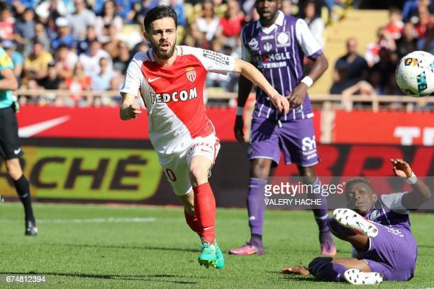 Monaco's Portuguese midfielder Bernardo Silva vies with Toulouse's Swiss defender Jacques Francois Moubandje during the French L1 football match...