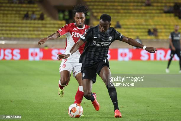 Monaco's Portuguese midfielder Gelson Batalha Martins fights for the ball with Sturm Graz's Kelvin Yeboah during the UEFA Europa League Group B...