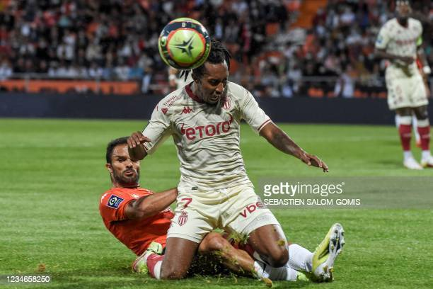 Monaco's Portuguese midfielder Gelson Martins is tackled by Lorient's Malagasy defender Jeremy Morel during the L1 football match between Lorient and...