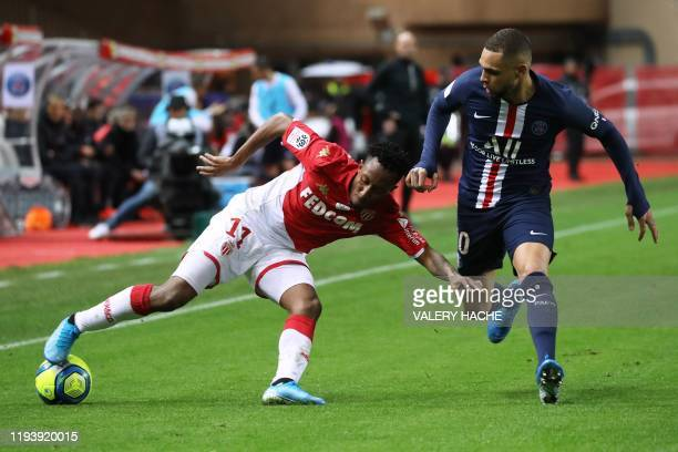 Monaco's Portuguese midfielder Gelson Martins vies for the ball with Paris SaintGermain's French defender Layvin Kurzawa during the French L1...