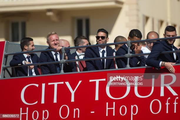 Monaco's Portuguese midfielder Joao Moutinho, Monaco's Polish defender Kamil Glik and Monaco's Colombian forward Radamel Falcao arrive at the...