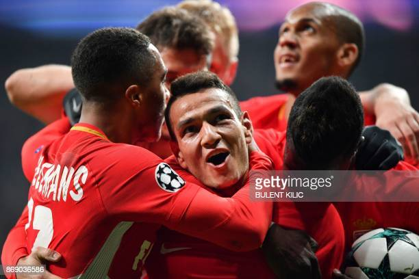 Monaco's Portuguese midfielder Rony Lopes celebrates with teammates after scoring a goal during the UEFA Champions League Group G football match...