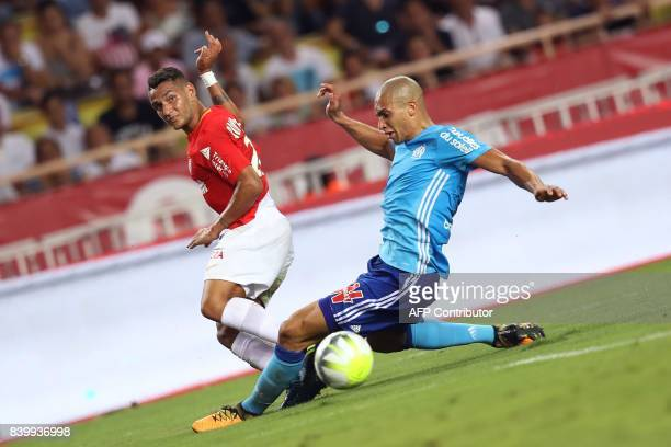 Monaco's Portuguese midfielder Rony Lopes vies for the ball with Marseille's Brazilian defender Matheus Doria Macedo during the French L1 football...