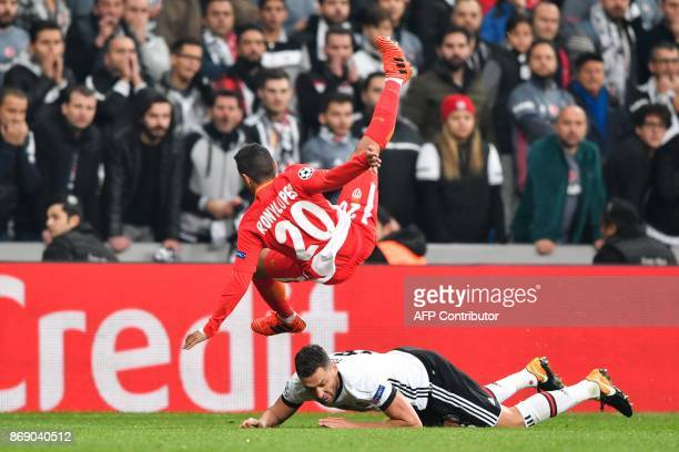 Monaco's Portuguese midfielder Rony Lopes vies with Besiktas' Turkish midfielder Tolgay Arslan during the UEFA Champions League Group G football...