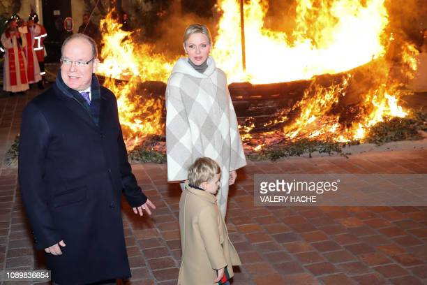 Monaco's Prince Albert II Princess Charlene and Prince Jacques take part in SainteDevote festivities on January 26 2019 in Monaco Saint Devote is the...
