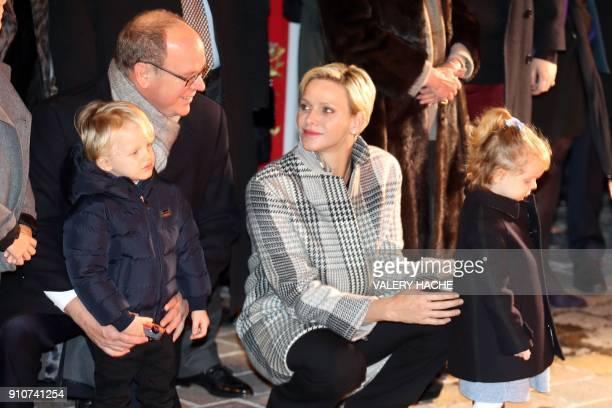 Monaco's Prince Albert II Princess Charlene Prince Jacques and Princess Gabriella take part in SainteDevote festivities on January 26 2018 in Monaco...