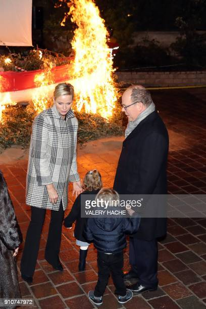 Monaco's Prince Albert II Princesse Charlene Prince Jacques and Princess Gabriella take part in SainteDevote festivities on January 26 2018 in Monaco...