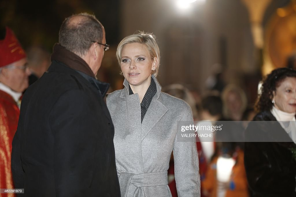 Monaco's Prince Albert II (L) speaks to Princess Charlene (L) on January 26, 2015 during a procession in Monaco celebrating the patron saint of Monaco and Corsica, Saint-Devote.