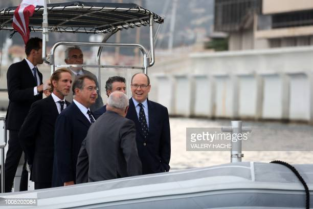 Monaco's Prince Albert shares a light moment with Archbishop of Monaco Bernard Barsi Martin Bouygues Monaco Minister of State Serge Telle Andre...