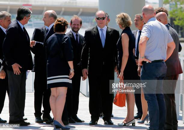 Monaco's Prince Albert stands with the Mayor of Bordeaux Alain Juppe First Deputy Mayor of Bordeaux Stephane Delau Virginie Calmels and Sylvie Caze...