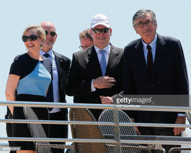 Monaco's Prince Albert stands with Virginie Calmels and First Deputy Mayor of Bordeaux Stephane Delau as they arrive on the boat 'Burdigala' at 'La...