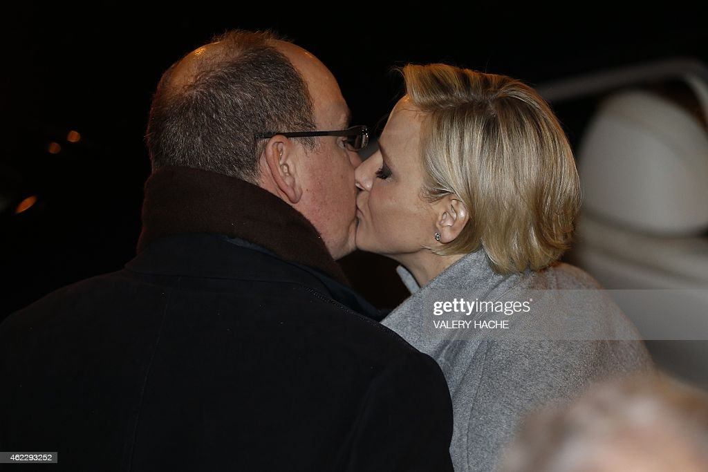 Monaco's Princess Charlene kisses Prince Albert II on January 26, 2015 during a procession in Monaco celebrating the patron saint of Monaco and Corsica, Saint-Devote.