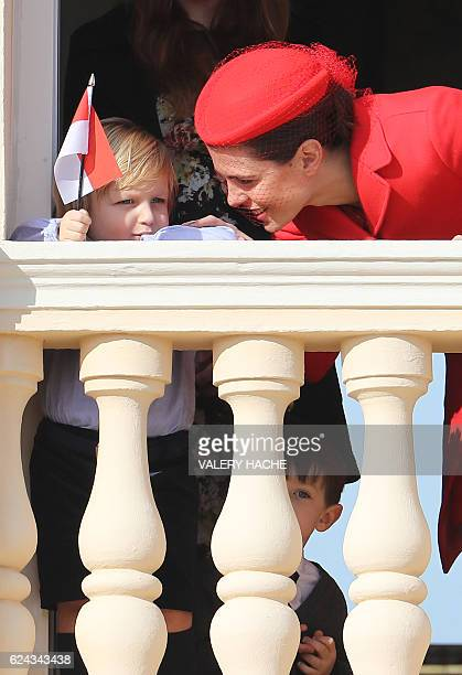 Monaco's Princess Charlotte Casiraghi speaks to Alexandre Casiraghi on the balcony of the Monaco Palace during the celebrations marking Monaco's...