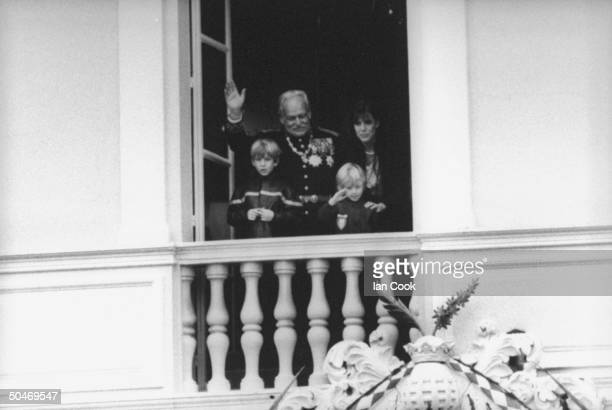 Monaco's royal family on palace balcony celebrating principality's National Day Prince Andrea Prince Rainier Prince Pierre Princess Caroline
