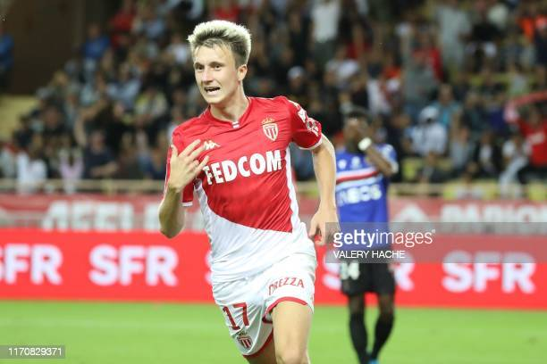 Monaco's Russian midfielder Aleksandr Golovin celebrates after scoring a goal during the French L1 football match between AS Monaco and OGC Nice at...