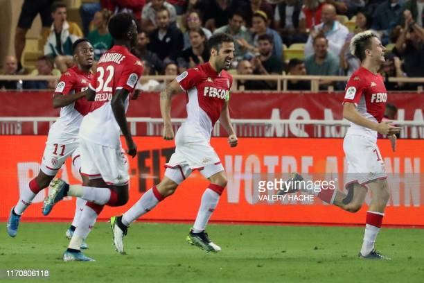 Monaco's Russian midfielder Aleksandr Golovin celebrates with team mates after scoring a goal during the French L1 football match between Monaco and...