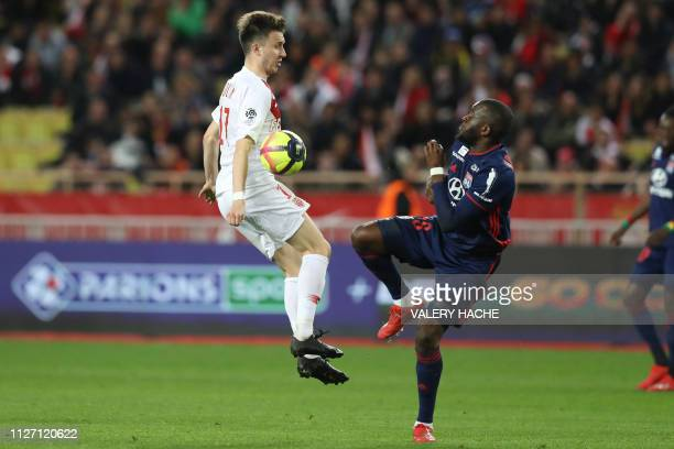 Monaco's Russian midfielder Aleksandr Golovin vies with Lyon's French midfielder Tanguy Ndombele during the French L1 football match Monaco vs Lyon...
