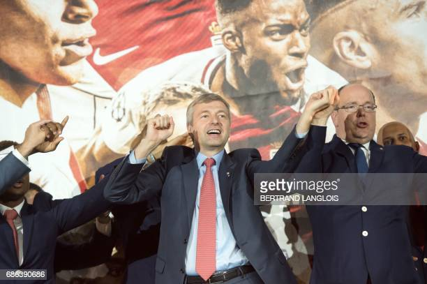 Monaco's Russian president Dmitriy Rybolovlev and Prince Albert II of Monaco acknowledge fans on May 21, 2017 in Monaco, during a celebration to mark...