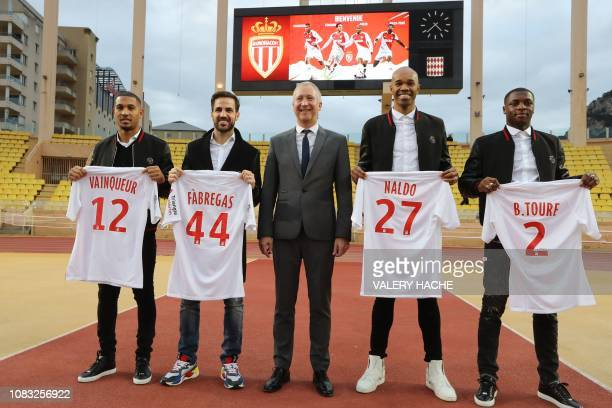 Monaco's Russian Vice club President Vadim Vasilyev poses next to Monaco's new players French midfielder William Vainqueur Spanish midfielder Cesc...