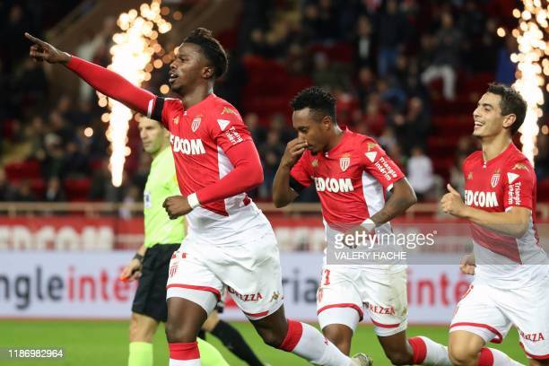 Monaco's Senegalese forward Keita Balde celebrates with teammates after scoring his team's third goal during the French L1 football match between...
