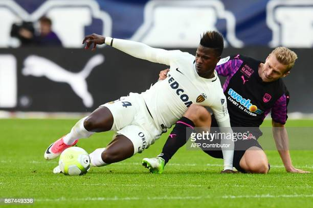 Monaco's Senegalese forward Keita Balde vies with Bordeaux's Polish defender Igor Lewczuk during the French L1 football match between Bordeaux and...