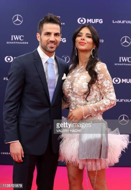 Monaco's Spanish footballer Cesc Fàbregas poses on the red carpet with his wife Daniella Semaan before the 2019 Laureus World Sports Awards ceremony...