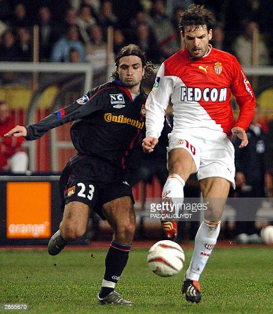 Monaco's Spanish forward Fernando Morientes is challenged by Lyon's defender Jeremie Berthod during their French L1 soccer match at Louis II stadium...