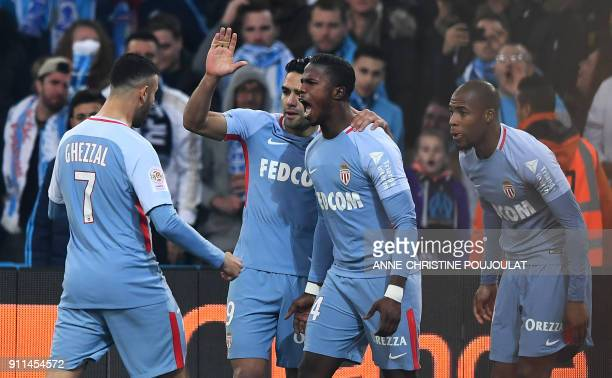 Monaco's Spanish forward Keita Balde celebrates with teammates after scoring a goal during the French L1 football match Marseille vs Monaco on...