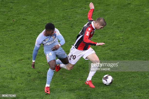 Monaco's Spanish forward Keita Balde fights for the ball with Nice's French defender Maxime Le Marchand during the French League Cup football match...
