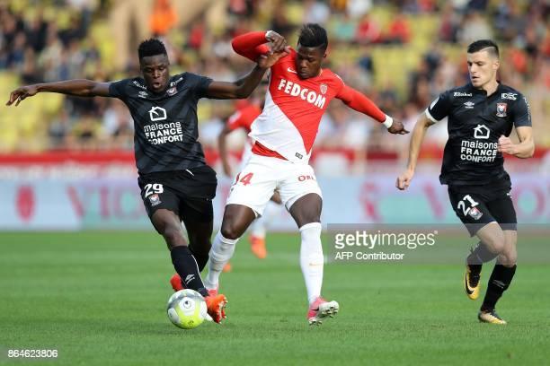 Monaco's Spanish forward Keita Balde vies with Caen's Haitian defender Romain Genevois during the French L1 football match Monaco vs Caen on October...