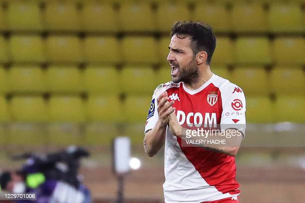 Monaco's Spanish midfielder Cesc Fabregas celebrates after scoring a penalty kick during the French L1 football match between Monaco and Paris...