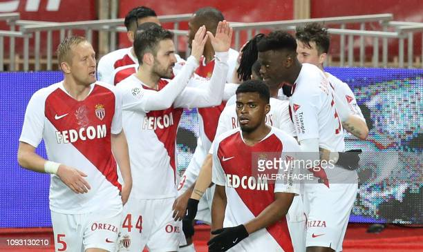 Monaco's Spanish midfielder Cesc Fabregas celebrates with teammates after scoring a goal during the French L1 football match Monaco vs Toulouse on...