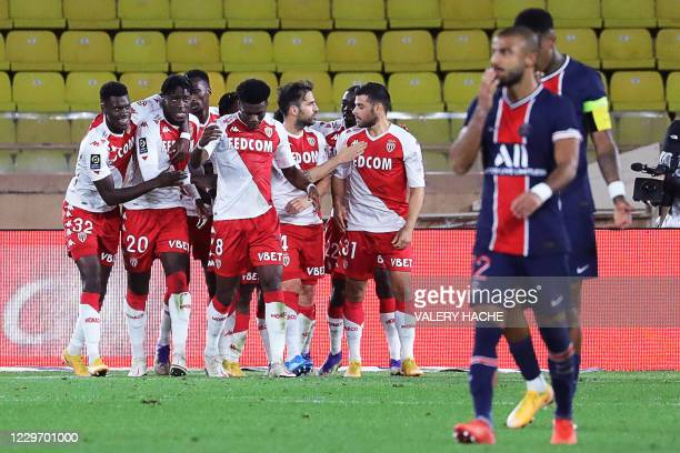 Monaco's Spanish midfielder Cesc Fabregas celebrates with teammates after scoring a penalty kick during the French L1 football match between Monaco...