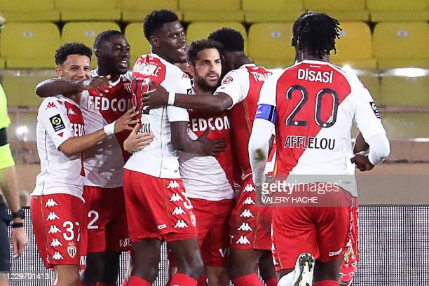 Monaco's Spanish midfielder Cesc Fabregas celebrates with teammates after scoring a penalty kickduring the French L1 football match between Monaco...