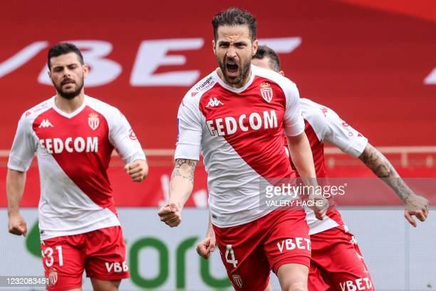Monaco's Spanish midfielder Cesc Fabregas celebrates with teammates after scoring a goal during the French L1 football match between AS Monaco and FC...