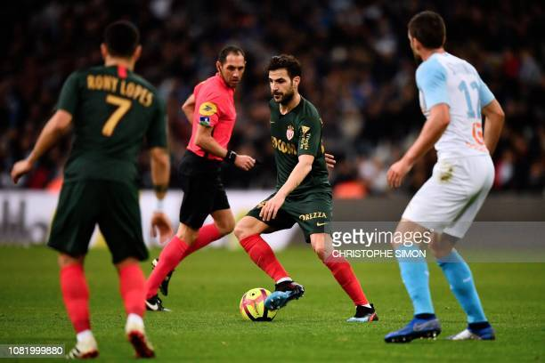 Monaco's Spanish midfielder Cesc Fabregas controls the ball during the French L1 football match between Olympique de Marseille and AS Monaco on...