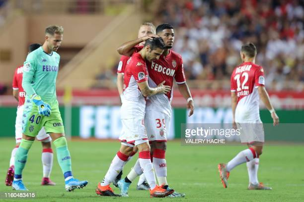 Monaco's Spanish midfielder Cesc Fabregas leaves after a red card during the French L1 football match between AS Monaco and Olympique Lyonnais at the...