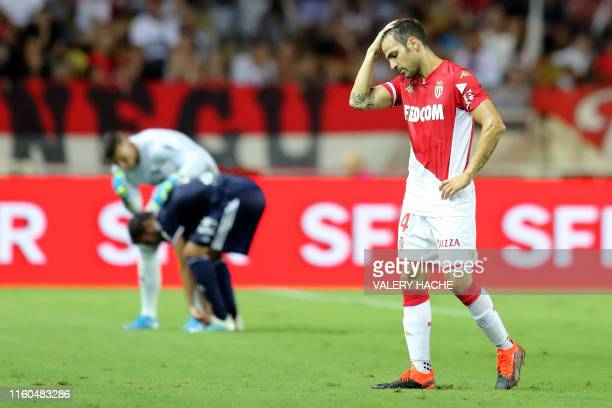 Monaco's Spanish midfielder Cesc Fabregas reacts during the French L1 football match between AS Monaco and Olympique Lyonnais at the Stade Louis II...