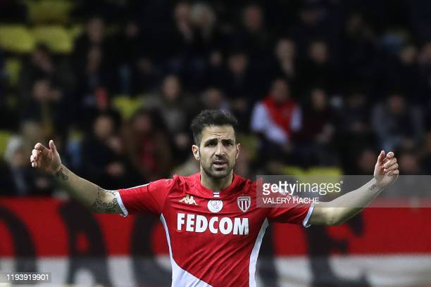 Monaco's Spanish midfielder Cesc Fabregas reacts during the French L1 football match between Monaco and Paris Saint-Germain at the Louis II Stadium...
