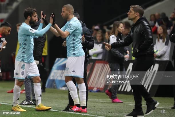 Monaco's Spanish midfielder Cesc Fabregas substitutes Monaco's Algerian forward Islam Slimani next to Monaco's Spanish coach Robert Moreno during the...