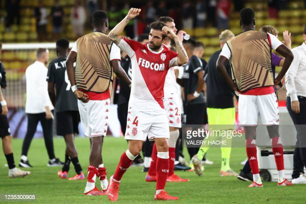 Monaco's Spanish midfielder Francesc Fabregas Soler reacts after winning the UEFA Europa League Group B first-leg football match between AS Monaco...