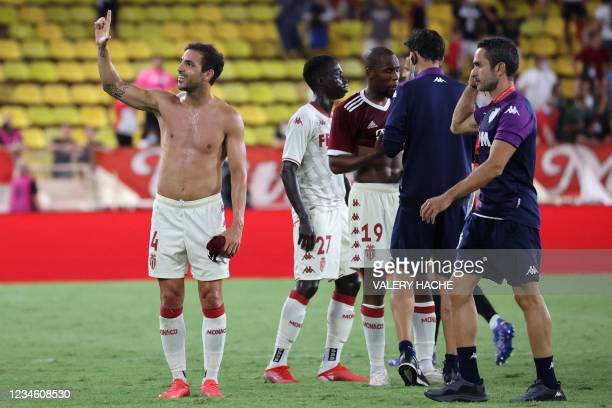 Monaco's Spanish midfielder Francesc Fabregas Soler reacts at the end of the Champions League match Q3 football match between AS Monaco and AC Sparta...