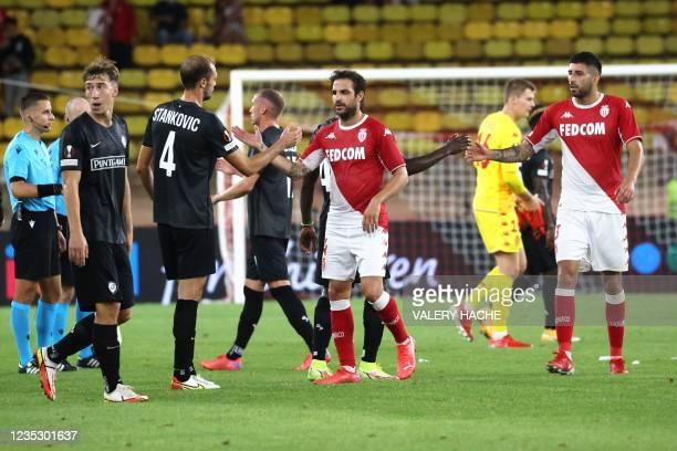 Monaco's Spanish midfielder Francesc Fabregas Soler shakes hands with Sturm Graz's Slovenian defender Jon Gorenc-Stankovic after winning the UEFA...