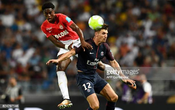 TOPSHOT Monaco's Swiss defender Terence Kongolo and Paris SaintGermain's Belgian defender Thomas Meunier head the ball during the French Trophy of...