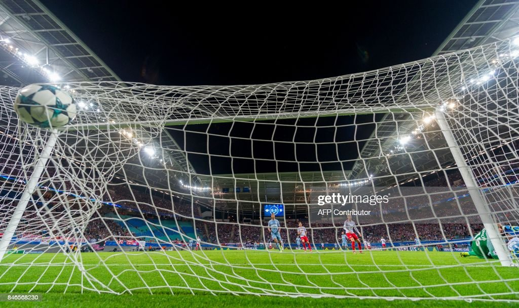 Monaco´s Swiss goalkeeper Diego Benaglio fails to safe the first goal by Leipzig´s Swedish forward Emil Forsberg during the UEFA Champions League group G football match RB Leipzig v AS Monaco in Leipzig, eastern Germany on September 13, 2017. /
