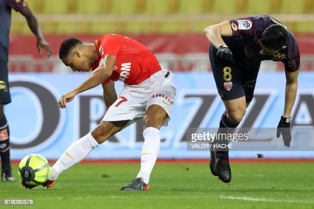 Monaco's Youri Tielemans vies with Dijon's FrenchAlgerian midfielder Mehdi Abeid during the French L1 football match Monaco vs Dijon on February 16...