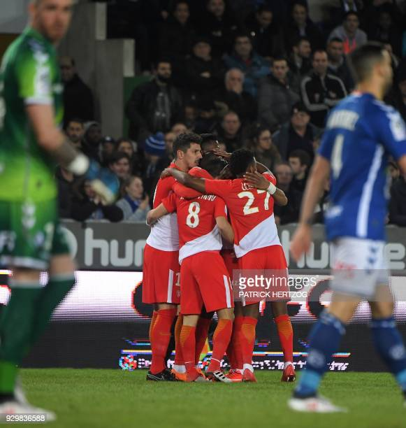 Monaco's Yugoslavian forward Stevan Jovetic celebrates with his teammates after scoring a goal during the French L1 football match between Strasbourg...