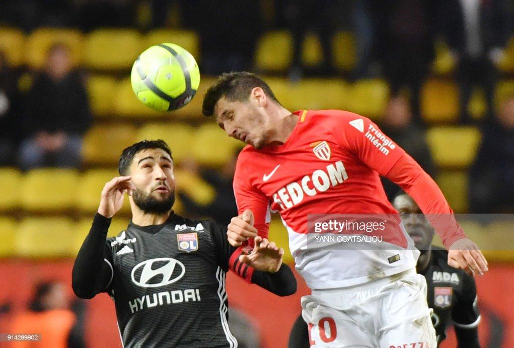 Monaco's Yugoslavian forward Stevan Jovetic (R) heads the ball with Lyon's French midfielder Nabil Fekir during the French L1 football match Monaco (ASM) vs Lyon (OL) on February 4, 2018 at Louis II stadium in Monaco. /