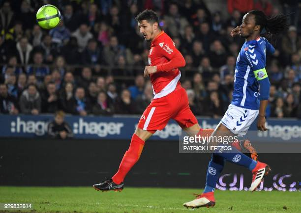 Monaco's Yugoslavian forward Stevan Jovetic scores a goal despite of Strasbourg's Burkinabe defender Bakary Kone during the French L1 football match...