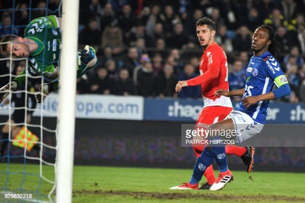 Monaco's Yugoslavian forward Stevan Jovetic scores a goal despite of Strasbourg's Burkinabe defender Bakary Kone and Strasbourg's French goalkeeper...